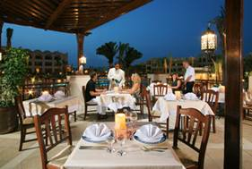 <b>Dining is a Breeze</b><br />Delicacies abound. Sea breezes caress the balmy evening air.<br />A romantic ambience soothes and relaxes.<br />